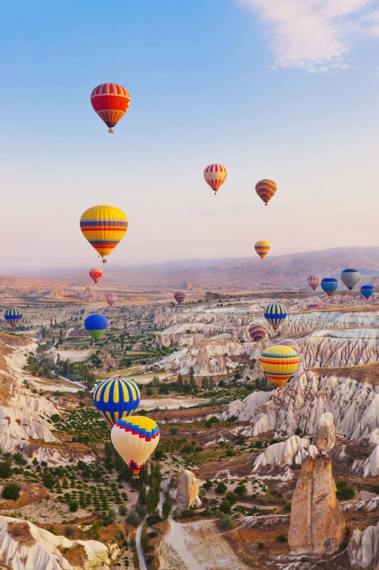 Soar above the valleys of Göreme, Capadocia.